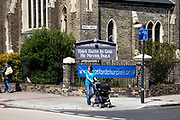 Scene of a mother pushing a pram outside a church in Stratford in East London. This is a relatively poor area of London, but in recent years has seen much regeneration, the construction of a major transport hub and various shopping complexes. Stratford is adjacent to the London Olympic Park and is currently experiencing regeneration and expansion linked to the 2012 Summer Olympics. (Photo by Mike Kemp/For The Washington Post)