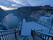"""Licensing - Open Edition Prints<br /> Shoshone Falls in sub-zero temperatures is a waterfall on the Snake River located approximately five miles east of Twin Falls, Idaho. Sometimes called the """"Niagara of the West,"""" Shoshone Falls is 212 feet (64.7 m) high—45 feet (14 m) higher than Niagara Falls—and flows over a rim 1,000 feet (305 m) wide. Shoshone Falls has existed at least since the end of the last ice age, when the Bonneville Flood carved much of the Snake River canyon and surrounding valleys. It is a total barrier to the upstream movement of fish. The falls were the upper limit of sturgeon, and spawning runs of salmon and steelhead could not pass the falls. Yellowstone cutthroat trout lived above the falls in the same ecological niche as Rainbow Trout below it. Due to this marked difference, the World Wide Fund for Nature used Shoshone Falls as the boundary between the Upper Snake and the Columbia Unglaciated freshwater ecoregions."""