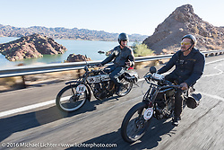 A pair of 1913 Thors ride together. Doug Feinsod (L) of California beside Jon Szalay of New Jersey as they ride by Lake Havasu during the Motorcycle Cannonball Race of the Century. Stage-14 ride from Lake Havasu CIty, AZ to Palm Desert, CA. USA. Saturday September 24, 2016. Photography ©2016 Michael Lichter.