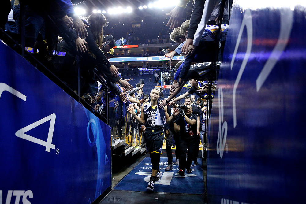 Golden State Warriors guard Stephen Curry (30) acknowledges the fans as he walks to the locker room following the NBA game against the Los Angeles Lakers at Oracle Arena on Saturday, Feb. 2, 2019, in Oakland, Calif. The Warriors won 115-101.