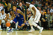 WACO, TX - JANUARY 7: Kelly Oubre Jr. #12 of the Kansas Jayhawks drives to the basket against the Baylor Bears on January 7, 2015 at the Ferrell Center in Waco, Texas.  (Photo by Cooper Neill/Getty Images) *** Local Caption *** Kelly Oubre Jr.