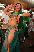Israel, Tel Aviv, A belly dancer dancing in the market