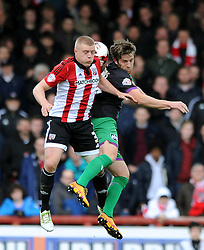 Adam Matthews of Bristol City challenges for the header with Jake Bidwell of Brentford - Mandatory by-line: Dougie Allward/JMP - 16/04/2016 - FOOTBALL - Griffin Park - Brentford, England - Brentford v Bristol City - Sky Bet Championship