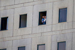 Two Iranian's standby a window at the Iranian parliament in the capital Tehran on June 7, 2017 during an attack on the complex. The Islamic State group claimed its first attacks in Iran as gunmen and suicide bombers killed at least five people in twin assaults on parliament and the tomb of the country's revolutionary founder in Tehran.Photo by Vahabzadeh FarsNews/ParsPix/ABACAPRESS.COM