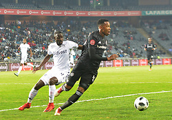 South Africa: Gauteng: Orlando Pirates player Happy Jele and Bidvest Wits Deon Hotto battle for the ball during the Absa Premiership at orlando stadium, Johannesburg.<br />Picture: Itumeleng English/African News Agency (ANA)