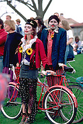 Man and woman age 25 at In the Heart of the Beast May Day Festival and Parade. Powderhorn Park Minneapolis  Minnesota USA