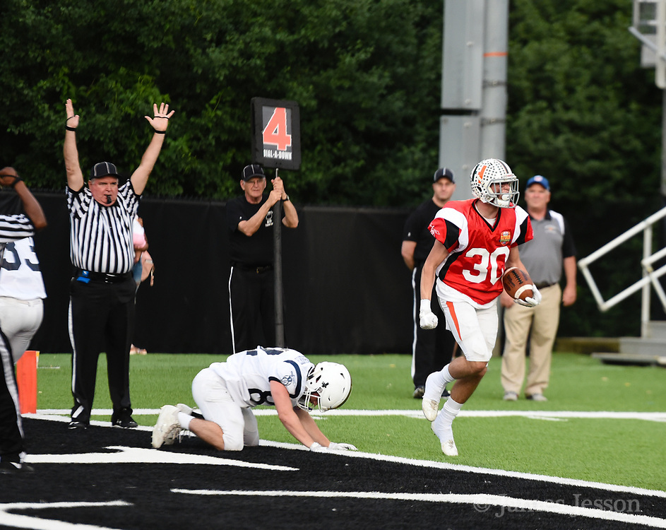 South Squad's Shane Cooney, from Hopkinton High School, celebrates after scoring during the Shriner's All-Star Football Classic at Bentley University in Waltham, June 22, 2018.   [Wicked Local Photo/James Jesson]