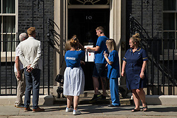 London, UK. 20th July, 2021. NHS Wales nurse Matthew Tovey presents his NHSPay15 petition signed by over 800,000 people calling for a 15% pay rise for NHS workers at 10 Downing Street accompanied by MPs Jeremy Corbyn and Lloyd Russell-Moyle and fellow campaigners. At the time of presentation of the petition, the government was believed to be preparing to offer NHS workers a 3% pay rise in 'recognition of the unique impact of the pandemic on the NHS'.