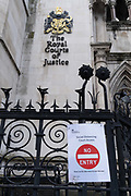A No Entry sign has been placed on the railings outside the Royal Courts of Justice The High Court outside the Royal Courts of Justice, during the third lockdown of the Coronavirus pandemic, on 3rd February 2021, in London, England. Judicial and legal proceedings have been put under great pressure during continued lockdowns with hearings and court cases severely delayed.