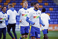 AFC Wimbledon defender Nesta Guinness-Walker (18) warming up prior to kick off during the EFL Sky Bet League 1 match between AFC Wimbledon and Bristol Rovers at Plough Lane, London, United Kingdom on 5 December 2020.