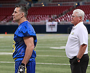 """Kurt Warner and Mike Martz watch the game. Martz coached the """"Blue"""" team, and Warner was QB for them."""