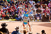 06 FEBRUARY 2011 - PHOENIX, AZ: SKY DUNCAN, an Apache Hidatsa Arikava Indian, from Mesa, AZ, performs at the 21st Annual Heard Museum World Championship Hoop Dance Contest at the Heard Museum in Phoenix, AZ, Sunday, February 6. Hoop dancing has a long tradition among Native American peoples. The hoop or circle is symbolic to most Native people. It represents the Circle of Life and the continuous cycle of summer and winter, day and night, male and female. Some native people use hoop dancing as a part of healing ceremonies designed to restore balance and harmony in the world.      Photo by Jack Kurtz