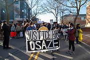 Protesters holding signs prepare to march on Allen Street in State College, Pennsylvania on March 19, 2021. The 3/20 Coalition organized a protest and march to mark the second anniversary of Osaze Osagie being shot and killed by State College police at his apartment. (Photo by Paul Weaver)
