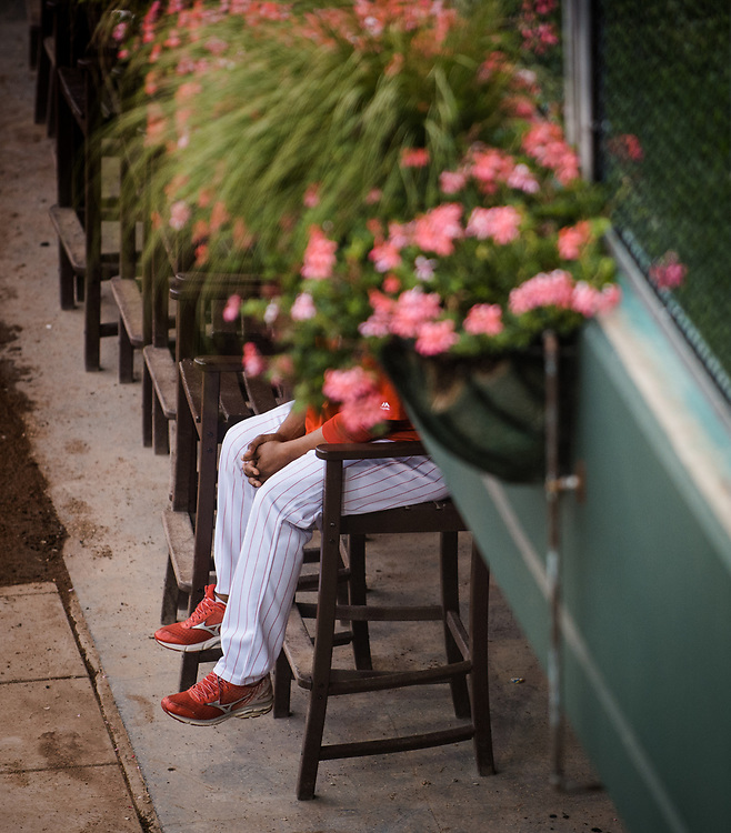 A Philadelphia Phillies pitching coach watches Phillies catcher Cameron Rupp warm up in the bullpen before facing the Atlanta Braves at Citizens Bank Park in Philadelphia, Pennsylvania on July 29 2017.