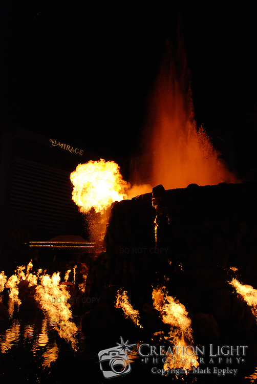 """The Mirage has a simulated volcano in front of the casino.  A scheduled times, the volcano """"erupts"""" and flames  around the lake and on top of the volcano gives a dazzling show of light and heat."""