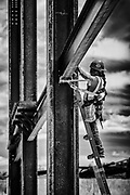 steel worker installing steel on commercial building
