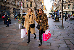 Glasgow, Scotland, UK. 19 November 2020. On the day before the highest level 4 lockdown is imposed on west and central Scotland, shops in Glasgow city centre and streets are busy with members of the public. Pictured;  Two women shopping on Buchanan Street. Iain Masterton/Alamy Live News