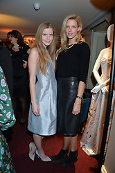 Left to right, KATIE READMAN and OLIVIA HUNT at a party hosted by Lady Kinvara Balfour, Lavinia Brennan and Lady Natasha Rufus Isaacs to celebrate the Beulah French Sole Collaboration in aid of the UN Blue Heart Campaign, held at George, 87-88 Mount Street, London on 10th December 2013.