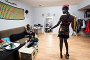 Designer Jacqueline Addison, left, owner of Akua Gabby, takes a video of model Setor Nyendu walking in one of her dresses during a fitting at Addison's studio in Northeast Minneapolis.
