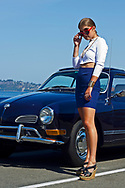 Model: Taylor Benson posing in front of a classic VW on Alki Trail wearing an outfit designed by Jessica Smith.