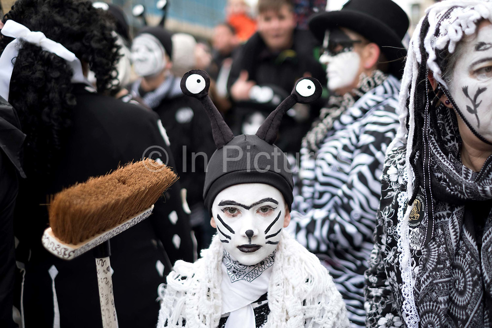 Pig Dyke Molly performers at the Straw Bear Festival in Whittlesey near Peterborough, United Kingdom on 13th January 2018. The traditional event was revived in 1980 and features a Straw Bear and its children being led through the streets of Whittlesey. The bear dances, while musicians break off into groups around the town square to perform with many different Morris, Molly, Sword, Mummer and Appalachian dancing teams