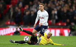 Tottenham Hotspur's Christian Eriksen (top) and Watford's Etienne Capoue battle for the ball during the Premier League match at Wembley Stadium. London.