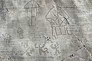 Petroglyph, rock carving, of a village with houses on stilts and a ceremony. Carved by the ancient Camunni people in the iron age between 1000-1200 BC. Rock no 24, Foppi di Nadro, Riserva Naturale Incisioni Rupestri di Ceto, Cimbergo e Paspardo, Capo di Ponti, Valcamonica (Val Camonica), Lombardy plain, Italy .<br /> <br /> Visit our PREHISTORY PHOTO COLLECTIONS for more   photos  to download or buy as prints https://funkystock.photoshelter.com/gallery-collection/Prehistoric-Neolithic-Sites-Art-Artefacts-Pictures-Photos/C0000tfxw63zrUT4<br /> If you prefer to buy from our ALAMY PHOTO LIBRARY  Collection visit : https://www.alamy.com/portfolio/paul-williams-funkystock/valcamonica-rock-art.html