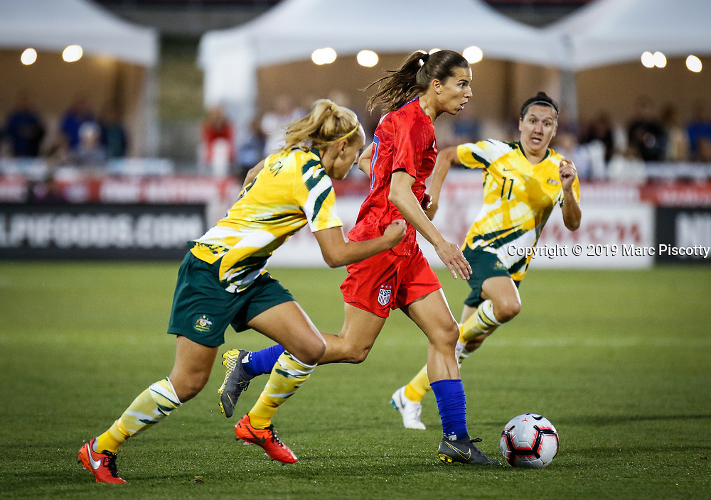 SHOT 4/4/19 6:31:44 PM - USA's Tobin Heath #17 tries to split a pair of Australian defenders including Gema Simon #2 and Lisa De Vanna #11 during their International Friendly at Dick's Sporting Goods Park in Commerce City, Colorado on April 4, 2019. The U.S. won the friendly 5-3. (Photo by Marc Piscotty / © 2019)