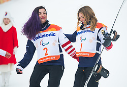 March 16, 2018 - Pyeongchang, South Korea - BRENNA HUCKABY, left, and AMY PURDY  of the US celebrate their gold (Huckaby) and bronze medal finishes in the Snowboard Banked Slalom event at Jeongseon Alpine Center at the Pyeongchang Winter Paralympic Games.  (Credit Image: © Mark Reis via ZUMA Wire)