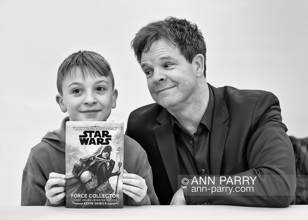 Merrick, New York, U.S.  December 20, 2019.  L-R, JAKE LEFEBURE, 10, of West Babylon, holding signed book, and author KEVIN SHINICK, 50, strike funny pose at book signing for Shinick's STAR WARS: FORCE COLLECTOR at North Merrick Library on Nassau County Force Collector Day. Author Shinick named home planet of Karr Nuq Sin, the main character of this canon Star Wars young adult novel, MEROKIA in honor of Merokee tribe who settled his Merrick hometown on Long Island.