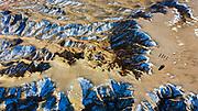Aerial landscape of tourists on top of the White Cliffs, Tsagaan Suvarga in Mongolia's Gobi Desert, Gobi Desert, Mongolia