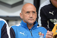 Richard Money, the Cambridge United manager looks on from the dugout before k/o. Skybet football league two match, Cambridge Utd v Portsmouth at the Abbey Stadium  in Cambridge on Saturday 10th October 2015.<br /> pic by John Patrick Fletcher, Andrew Orchard sports photography.
