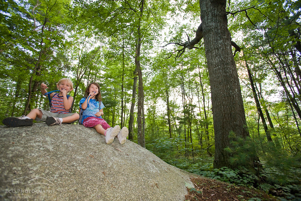 Two young hikers at the Willow Brook and Fleetwood Farms Preserve in Pembroke, Massachusetts.
