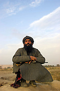 """An afghan mujahideen known as """"The Arab"""" watches B52's fly past en route to attacking Taliban positions."""