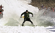 Warwick, NY - A skier crosses the water at the end of a run during the Spring Rally at Mount Peter in Warwick on March 29, 2008.