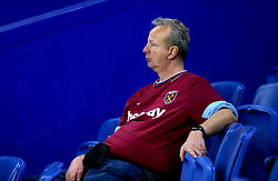 A West Ham United fan in the stands prior to the match kick off
