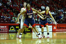 24 March 2011: Emily Hanley gets screened out by Wumi Agunbiade and Alex Gensler during a WNIT (Women's National Invitational Tournament Women's basketball sweet 16 game between the Duquesne Dukes and the Illinois State Redbirds at Redbird Arena in Normal Illinois.