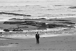 SDP leader Dr David Owen on Scarborough beach before a bomb scare emptied the conference hall.