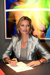 Kate Moss - From the Collection of Gert Elfering Sale. <br /> British Model Kate Moss during the preview for the September 25th auction which will present a selection of works in various media celebrating Kate Moss, Christie's, London, United Kingdom. Wednesday, 4th September 2013. Picture by Ben  Stevens / i-Images
