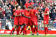 James Milner of Liverpool (c) celebrates with his teammates after scoring his teams 5th goal. Premier League match, Liverpool v Hull City at the Anfield stadium in Liverpool, Merseyside on Saturday 24th September 2016.<br /> pic by Chris Stading, Andrew Orchard sports photography.