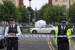 © Licensed to London News Pictures.  01/09/2021. London, UK. Police guard a crime scene after a teenager was shot dead in Leyton, east London. Police were called around 1:30am to reports of gunshots, a short time later man in his late teens was found suffering with gunshot wounds. The victim prounanced dead in the street at 2:28am. Photo credit: Marcin Nowak/LNP