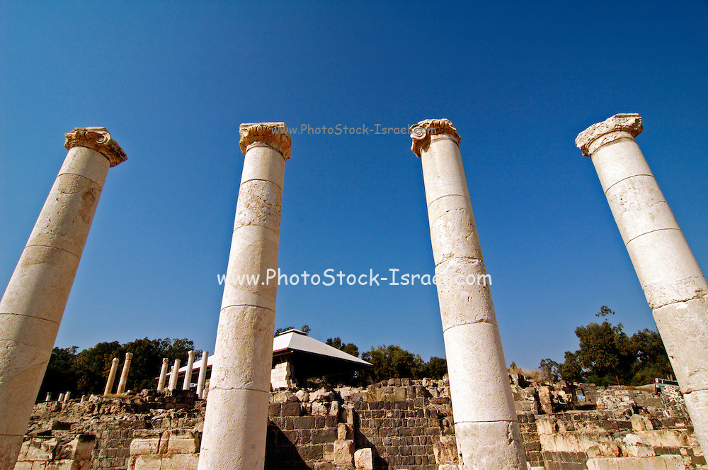 """Israel, Bet Shean ancient columns found on the site, During the Hellenistic period Bet Shean had a Greek population and was called Scythopolis. In 64 BCE it was taken by the Romans, rebuilt, and made the capital of the Decapolis, the """"Ten Cities"""" of Samaria that were centers of Greco-Roman culture. The city contains the best preserved Roman theater of ancient Samaria as well as a hippodrome, cardo, and other trademarks of the Roman influence. Excavations at the cite are ongoing at the site and reveal no less than 18 successive ancient towns"""