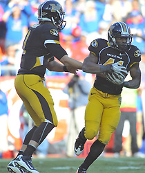 Nov 27, 2010; Kansas City, MO, USA; Missouri Tigers quarterback Blaine Gabbert (11) hands off to running back Henry Josey (41) in the second half of the game against the Kansas Jayhawks at Arrowhead Stadium. Missouri won 35-7.  Mandatory Credit: Denny Medley-US PRESSWIRE