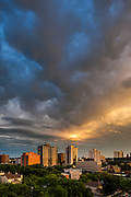 Saskatoon skyline, stormy summer sunset. This image makes outstanding wall decor as a metal print.