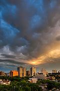 Saskatoon skyline, stormy summer sunset. This image makes outstanding wall decor as a metal print.