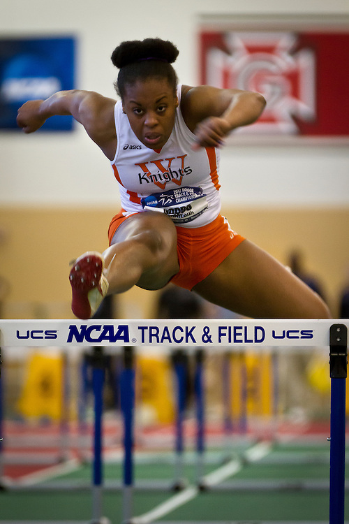 Wartburg Pentathlete Camesha Goods leaps over the final hurdle during the 60m Hurdles on Friday of the NCAA Division III Indoor Track and Field National Championships.