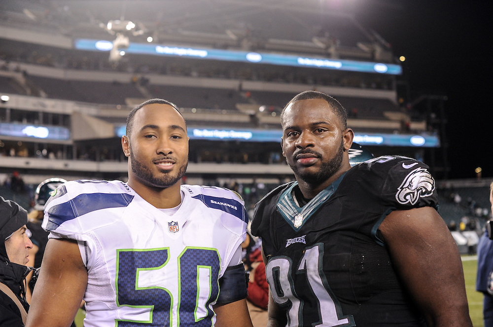 Philadelphia Eagles defensive end Fletcher Cox (91) and Seattle Seahawks outside linebacker K.J. Wright (50) after the game at Lincoln Financial Field on Dec 7, 2014 in Philadelphia, Pa. (Photo by John Geliebter/Philadelphia Eagles)