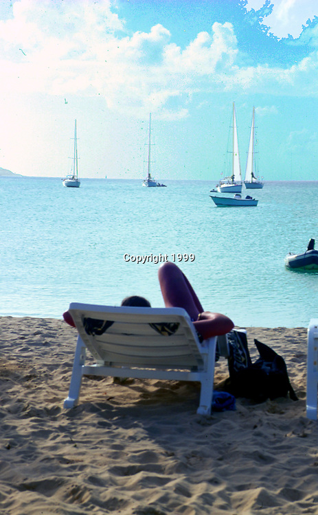 Woman relaxing on beach in Anguilla, British West Indies