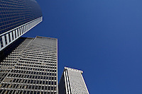 Architectural photograph of modern buildings of New York, with negative space covered by blue sky.