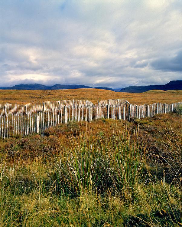 Snow fences cross Rannoch Moor in the Central Highlands of Scotland.